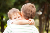 Child hugging daddy. — Stock Photo