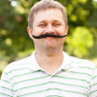 Man with fake mustache — Stock Photo