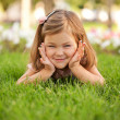 Happy beautiful little girl on the grass — Stock Photo #30099135