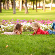Little boy and girl lying on the grass — Stock Photo #30099227