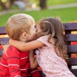 Stock Photo: Love concept. Couple of kids kissing.