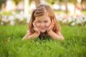Happy beautiful little girl on the grass — Stock Photo