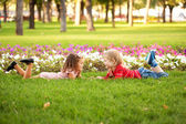 Little boy and girl lying on the grass — Stock Photo