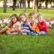 Group of children relaxing and playing in the park  — Stock Photo