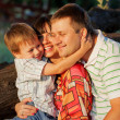 Father, mother and son hugging — Stock Photo