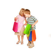 Family shopping. Young couple with shopping bags. — Stock Photo