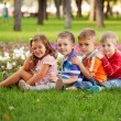 Group of fun children on the green grass. — Stok fotoğraf