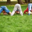 Three little boys turning somersaults — Stock Photo