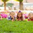 Stok fotoğraf: Group of little children relaxing in park