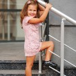 Little girl on the stairs. — Stock Photo