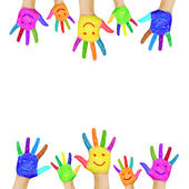 Frame of colorful hands painted with smiling faces. — Stock Photo