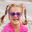 Funny little girl wearing a sunglasses — Stock Photo #33742411
