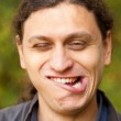 Man making grimace face, Troll face. — Stock Photo #34310799
