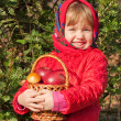 Stock Photo: Funny little girl with mushrooms and apples