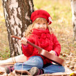 Funny little girl playing guitar — Stock Photo