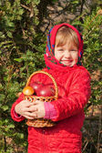 Funny little girl with mushrooms and apples — Stock Photo