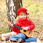 Lovely little girl playing guitar — Stock Photo