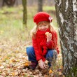 Little girl picking mushrooms. Fall concept. — Stock Photo