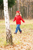 Happy smiling little girl running in forest — Foto Stock