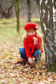 Little girl picking mushrooms. Fall concept. — Stock Photo