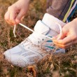 Hands tying the laces on sports shoes — Stock Photo
