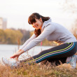 Happy middle-aged woman doing  stretching exercises — Stock Photo