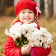 Happy little girl with bouquet for the mother. — Stock Photo