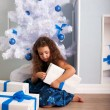 Happy little girl holding gifts. Christmas concept — Stock Photo