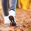 Close-up running feet outdoors. — Stock Photo