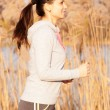 Woman jogging outdoors. Healthy lifestyle concept. — Stock Photo