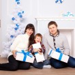 Funny family holding gifts. Christmas concept. — Stock Photo