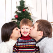 Mother and father kissing their kid — Stock Photo