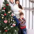 Funny family near the Christmas tree. — Stock Photo