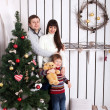 Happy family near the Christmas tree.  — Stockfoto