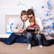 Funny family using the tablet — Stock Photo