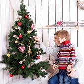 Father and kid decorating the Christmas tree — Stock Photo
