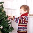 Happy child decorating the Christmas tree — Stock Photo