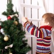Christmas Eve concept, child decorating Christmas tree — Stock Photo