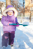 Happy smiling child playing with snow — Stock Photo