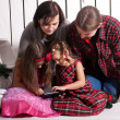 Happy family using the tablet. — Stock Photo