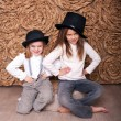 Stock Photo: Two girls in black hats