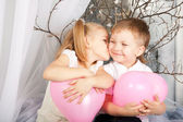 Little couple of kids hugging, kissing — Stock Photo