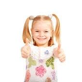 Smiling kid showing thumbs up symbol. — Stock Photo