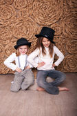Two girls in black hats — Stock Photo
