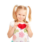 Little smiling child holding Felt heart. — Zdjęcie stockowe