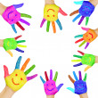 Human hands painted in colorful paint with smiles. — Stock Photo #39106697