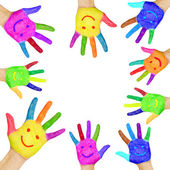 Human hands painted in colorful paint with smiles. — Stock Photo