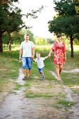 Father, mother and son walking outdoors. — Stock Photo
