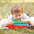 Stockfoto: Little boy and books outdoors. Back to school.