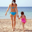 Mother and daughter on the sandy beach. — Stock Photo